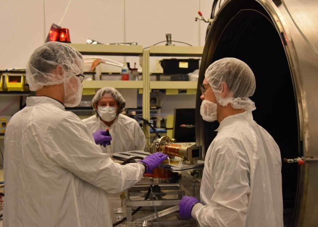 Members of the Mars 2020 Perseverance rover Mastcam-Z hardware development group work out the details for thermal vacuum testing of the Engineering Qualification Model camera at ASU in November, 2018.