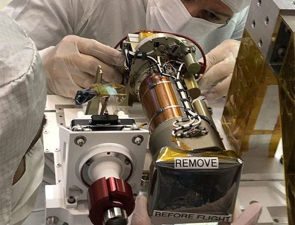JPL technician Seth Harvey installs the left Mastcam-Z camera head during the June 2019 integration of the Mars 2020 mission's Perseverance rover's remote sensing mast (RSM).