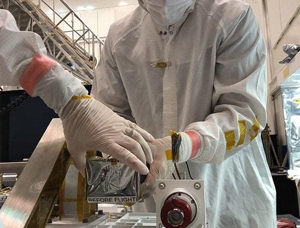 JPL technician Seth Harvey installs the right Mastcam-Z camera head during the June, 2019 integration of the Perseverance rover's remote sensing mast (RSM).
