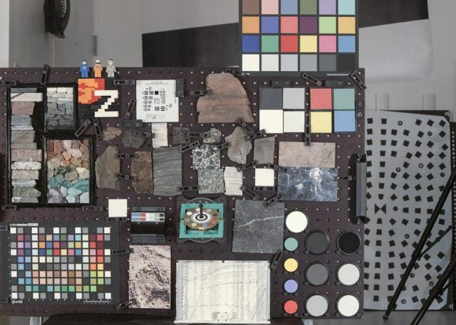 """A wide-angle RGB photo of the """"GeoBoard"""" (color calibration targets, geometric calibration targets, and natural geologic samples with lots of color and texture, all designed to put the color and resolution capabilities of the cameras to the test) taken by the Mastcam-Z flight left camera at the 34 mm zoom setting. This target is about as far away from the cameras as typical outcrop rocks might be on Mars, giving an idea of the image quality and field of view that will be available."""